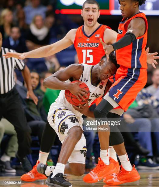 Gibbs of the Notre Dame Fighting Irish collides with Ayo Dosunmu of the Illinois Fighting Illini at Purcell Pavilion on November 27 2018 in South...