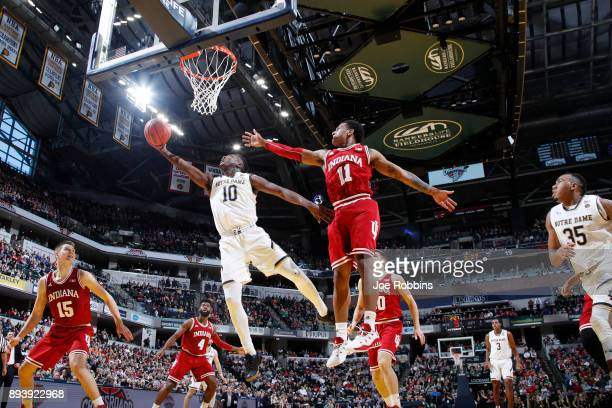Gibbs of the Notre Dame Fighting Irish drives to the basket against Devonte Green of the Indiana Hoosiers in the first half of the Crossroads Classic...