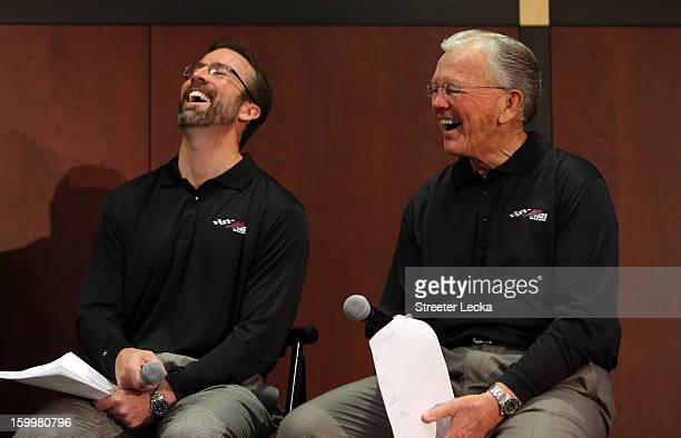 JD Gibbs President of JGR sits beside his father and team owner Joe Gibbs as they speak to the media during the 2013 NASCAR Sprint Media Tour on...