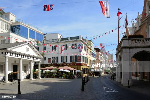 gibraltar - convent place square, main street - residence of the governor of gribraltar (the convent) and its guard house - convent stock photos and pictures