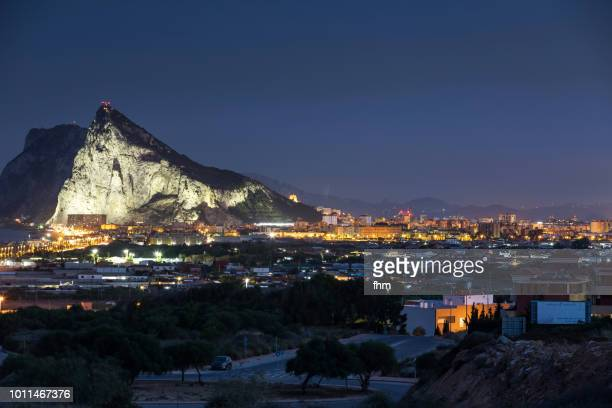 gibraltar rock and la linea de la conception at blue hour - morocco (africa) in the background (spain and gibraltar/ uk) - rock of gibraltar stock photos and pictures