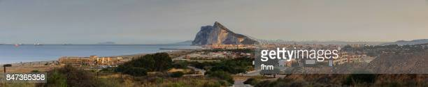 gibraltar rock and la linea de la conception at twilight - morocco (africa) in the background (spain and gibraltar/ uk) - la linea de conception stock pictures, royalty-free photos & images
