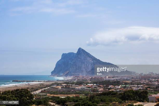 gibraltar rock and la linea de la conception - morocco (africa) in the background (spain and gibraltar/ uk) - la linea de conception stock pictures, royalty-free photos & images