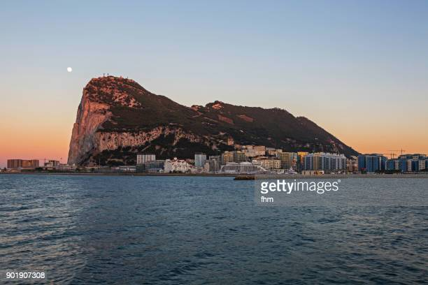 gibraltar sunset with moon - city and upper rock - gibraltar/ uk - la linea de conception stock pictures, royalty-free photos & images