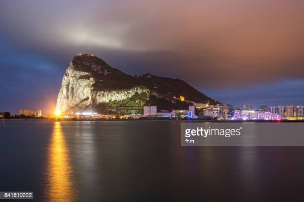 "gibraltar - view to ""upper rock"" with a large cloud (gibraltar/ uk) - rock of gibraltar stock photos and pictures"