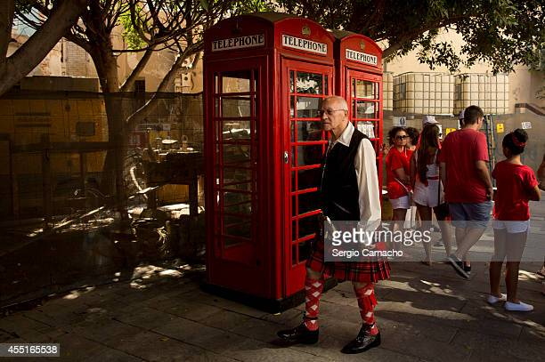 Gibraltarian walking dress with untare typical during Gibraltar National Day celebrations on September 10 2014 in Gibraltar Gibraltar National Day is...