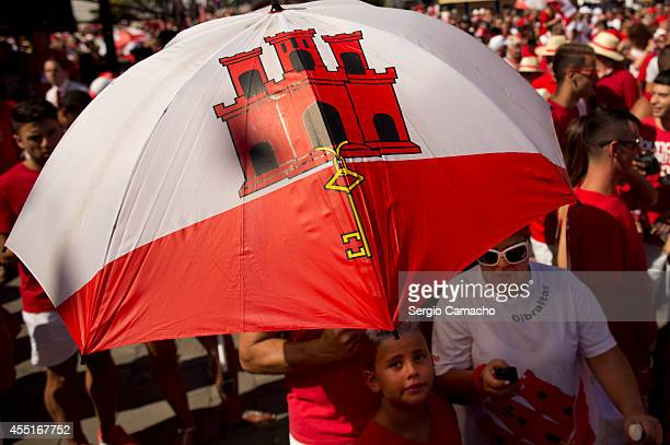 Gibraltarians to protect themselves from the sun during Gibraltar National Day celebrations on September 10 2014 in Gibraltar Gibraltar National Day...