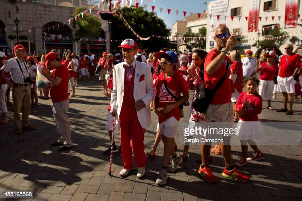 Gibraltarians walk before the rally during Gibraltar National Day celebrations on September 10 2014 in Gibraltar Gibraltar National Day is the...