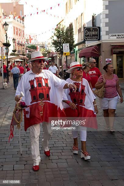 Gibraltarians walk disguised during Gibraltar National Day celebrations on September 10 2014 in Gibraltar Gibraltar National Day is the official...
