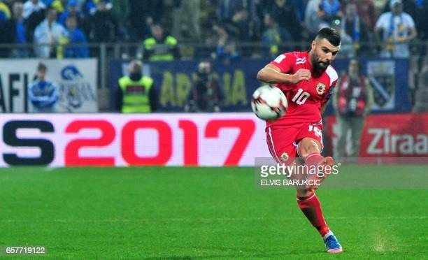 Gibraltar's Liam Walker shoots the ball during the FIFA World Cup 2018 qualification football match between Bosnia and Herzegovina and Gibraltar in...