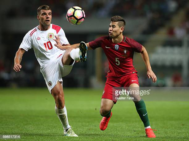 Gibraltar«s midfielder Liam Walker with PortugalÕs defender Raphael Guerreiro in action during the International Friendly match between Portugal and...