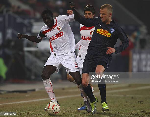 Gibril Sankoh of Augsburg battles for the ball with Kevin Vogt of Bochum during the Second Bundesliga match between FC Augsburg and VfL Bochum at...