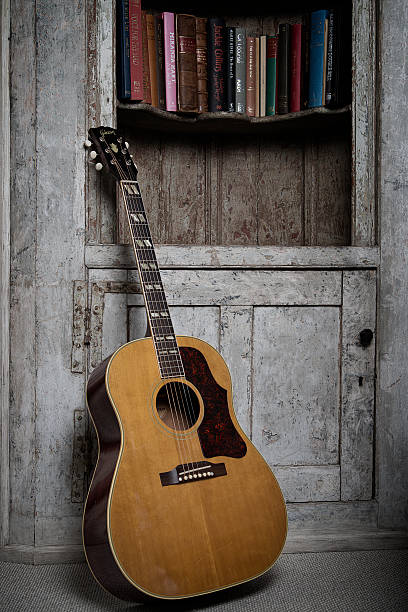 https://media.gettyimages.com/photos/gibson-acoustic-guitar-belonging-to-english-indie-rock-musician-frank-picture-id536460540?k=6&m=536460540&s=612x612&w=0&h=ccnQKLuqaLR17NHe9i4wpQdfmHplXXWVD30GZ3ro4fQ=