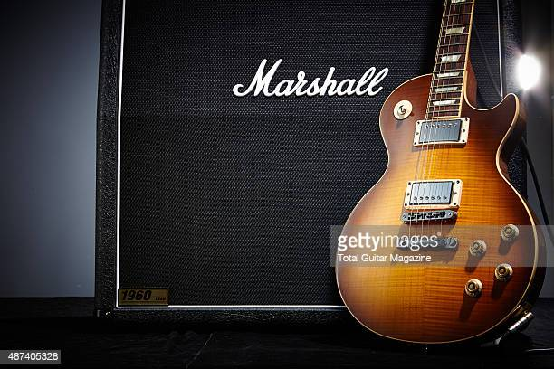 A Gibson Les Paul electric guitar photographed resting against a Marshall amplifier taken on July 29 2014