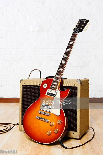 Gibson Les Paul electric guitar with retro-styled amplifier