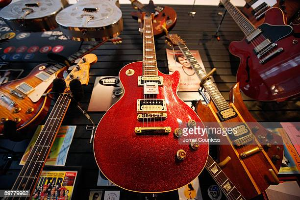 Gibson Les Paul guitars are displayed at the ''30th Street Guitars'' shop on August 13 2009 in New York City Guitar pioneer Les Paul died August 13...