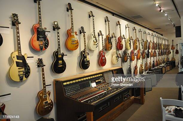 Gibson Les Paul guitars line the wall of an auction house on June 9 2012