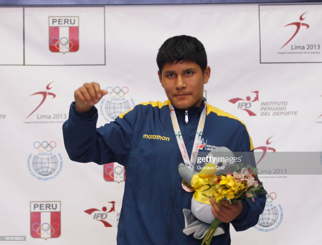 Gibson Rios of Ecuador in the podium of Boxing 56kg as part of the I ODESUR South American Youth Games at Coliseo Miguel Grau on September 25, 2013 in Lima, Peru.