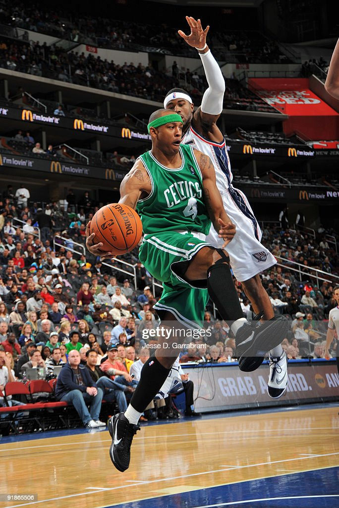 J.R. Giddens #4 of the Boston Celtics passes against Terrence Williams #8 of the New Jersey Nets during the pre-season game on October 13, 2009 at the Prudential Center in Newark, New Jersey.