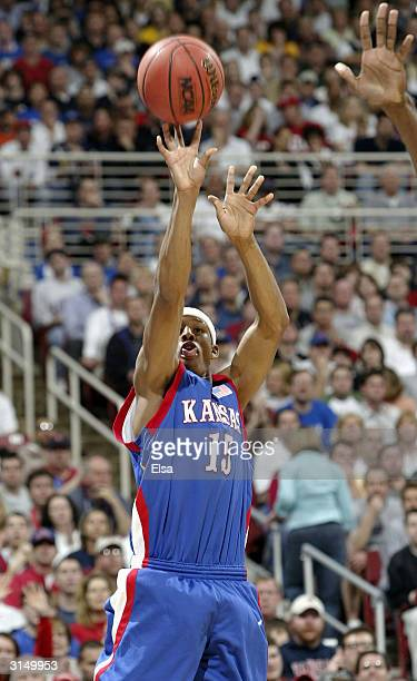 Giddens of the Kansas Jayhawks shoots a three-pointer against the Georgia Tech Yellow Jackets during the fourth round game of the NCAA Division I...