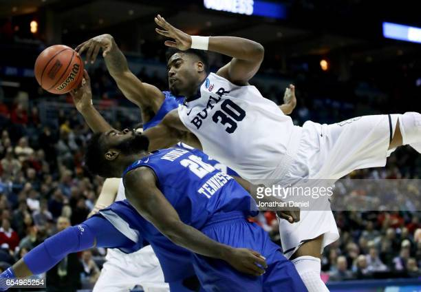 Giddy Potts of the Middle Tennessee Blue Raiders fouls Kelan Martin of the Butler Bulldogs in the second half during the second round of the 2017...