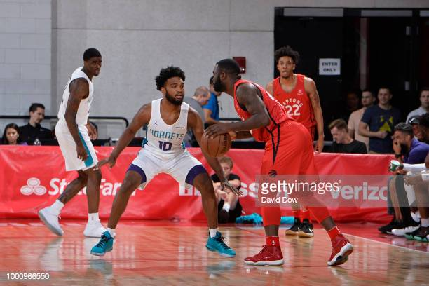 Giddy Potts of the Toronto Raptors handles the ball against the Charlotte Hornets during the 2018 Las Vegas Summer League on July 14 2018 at the Cox...
