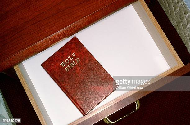 gideon bible in hotel drawer - drawer stock pictures, royalty-free photos & images