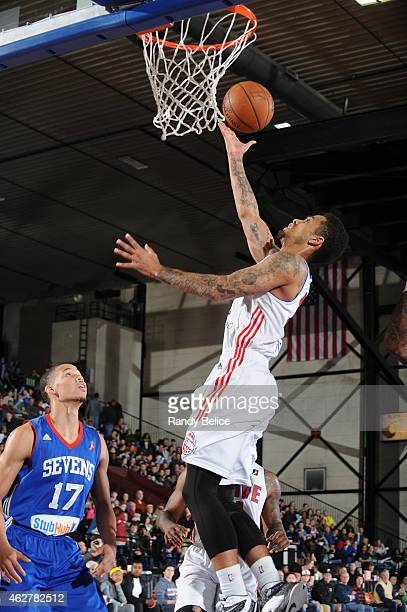 Gideon Gamble of the Grand Rapids Drive goes to the basket past Jared Cunningham of the Delaware 87ers during the NBA D-League game on January 31,...
