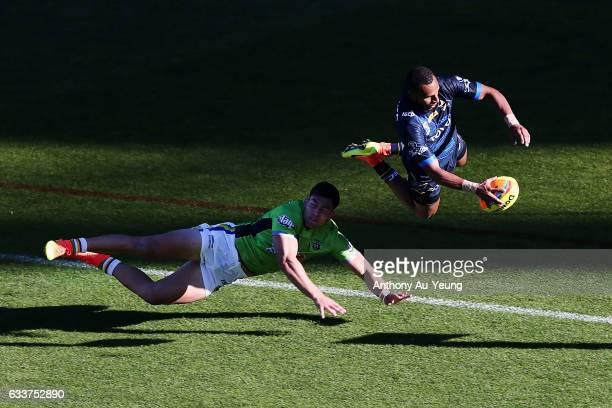 Gideon GelaMosby of the Cowboys scores a try against Nick Cotric of the Raiders during the 2017 Auckland Nines match between the Cowboys and the...
