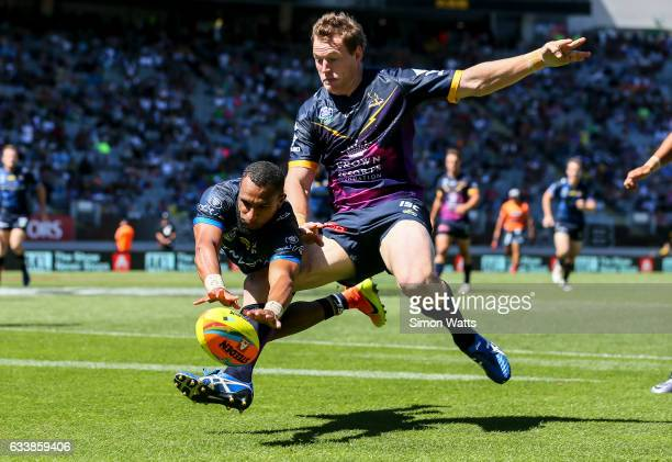 Gideon Gela-Mosby of the Cowboys scores a try in the tackle of Tim Glasby of the Storm during the 2017 Auckland Nines quarter final match between the...