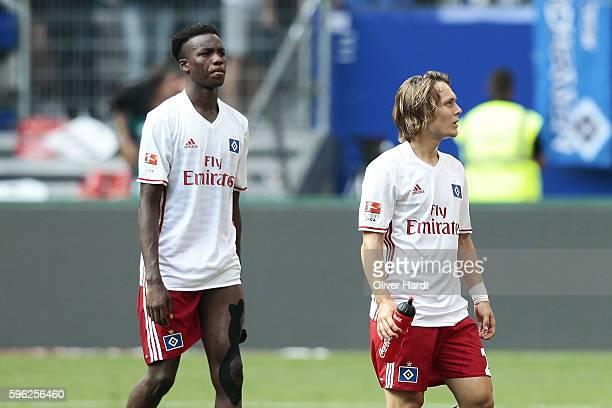 Gideon Jung and Alen Halilovic of Hamburg appears frustrated after the Bundesliga match between Hamburger SV and FC Ingolstadt 04 at Volksparkstadion...