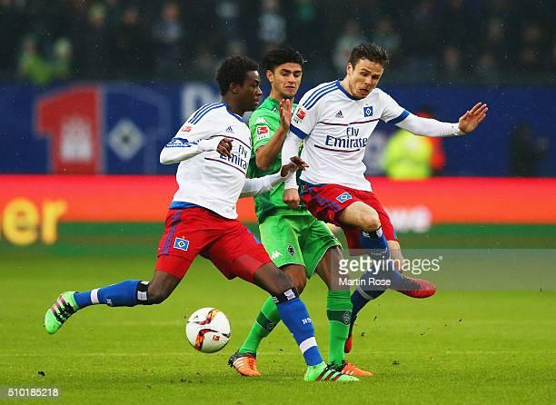 Gideon Jung and Nicolai Mueller of SV Hamburg block Mahmoud Dahoud of Borussia Moenchengladbach during the Bundesliga match between Hamburger SV and...