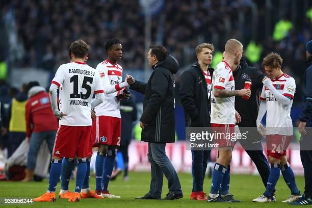 Gideon Jung Head coach Christian TitzJann Fiete ArpRick van Drongelen and Gotoku Sakai of Hamburg appears frustrated after the Bundesliga match...