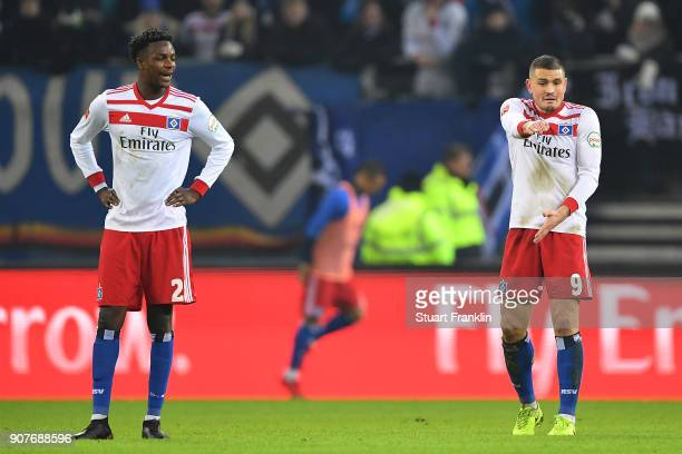 Gideon Jung of Hamburg and Kyriakos Papadopoulos of Hamburg dejected after they conceded their first goal during the Bundesliga match between...