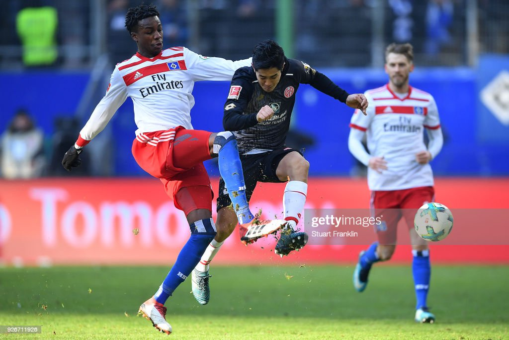 Gideon Jung of Hamburg (l) fights for the ball with Yoshinori Muto of Mainz during the Bundesliga match between Hamburger SV and 1. FSV Mainz 05 at Volksparkstadion on March 3, 2018 in Hamburg, Germany.