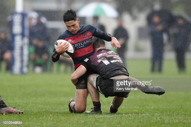 Gideon Kautai of Hastings Boys High School is tackled during the Schools Super 8 match between Hastings Boys High and Hamilton Boys High at Hastings...