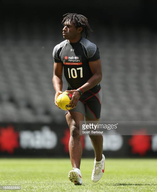 Gideon Simon of Mt Hagen Papua New Guinea kicks the ball as he takes part in the goalkicking assessment during the 2012 AFL Draft Combine at Etihad...