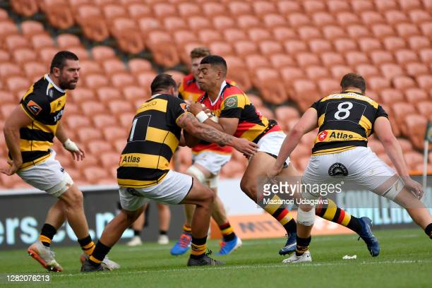 Gideon Wrampling of Waikato is tackled during the round 7 Mitre 10 Cup match between Waikato and Taranaki at FMG Stadium on October 25 2020 in...