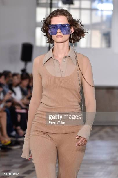 Giedre Dukauskaite walks the runway during the Acne Studios Womenswear Spring Summer 2019 show during the Paris Fashion Week on July 1 2018 in Paris...