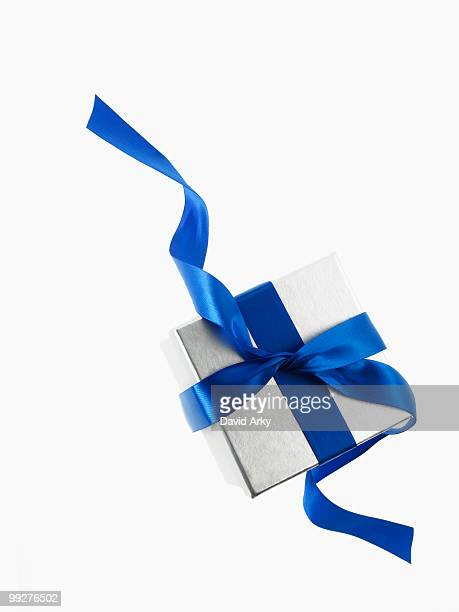 gift and blue ribbon - blue ribbon stock photos and pictures