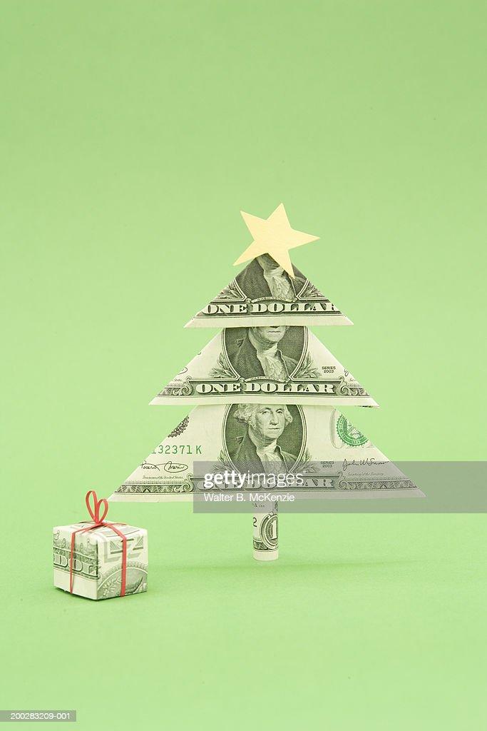 Christmas Tree Bill.Gift And Christmas Tree Made Of Us Dollar Bills Stock Photo