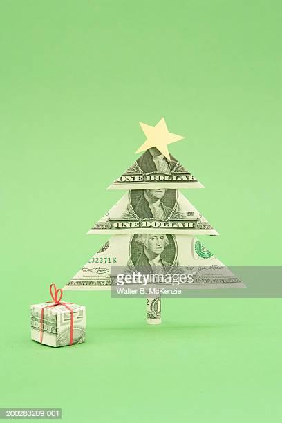 Gift and Christmas tree made of US dollar bills