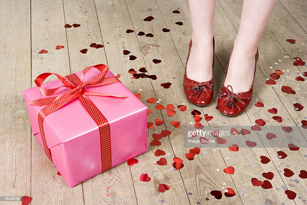 Gift and feet of woman : Stock Photo