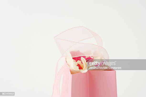 Gift bag, flowers sticking out