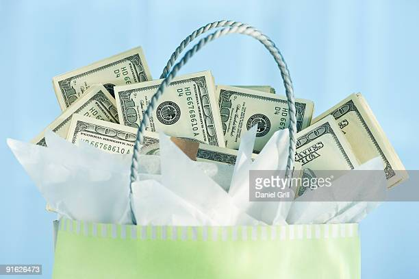 A gift bag with bank notes
