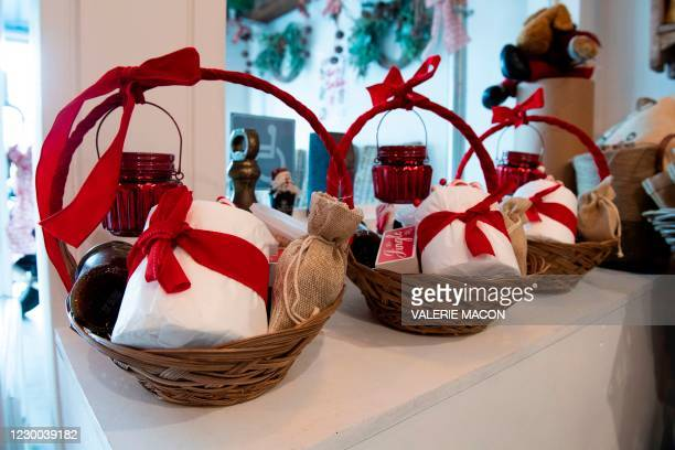 """Gift baskets containing toilet paper are displayed inside """"La Loupiotte Kitchen"""", a restaurant trying to adapt and attract more customers amid the..."""