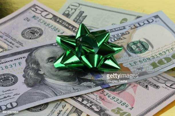 Gift bow decorating a gift of money
