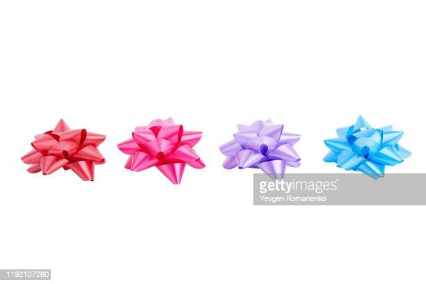gift bows in assorted colours, isolated on white background - tied bow stock pictures, royalty-free photos & images