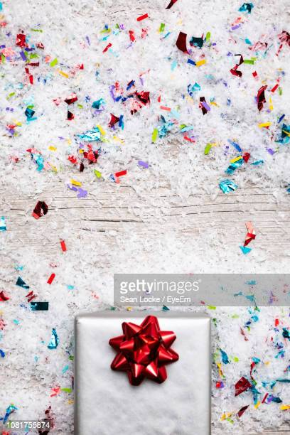 gift box and confetti on table - fake snow stock pictures, royalty-free photos & images