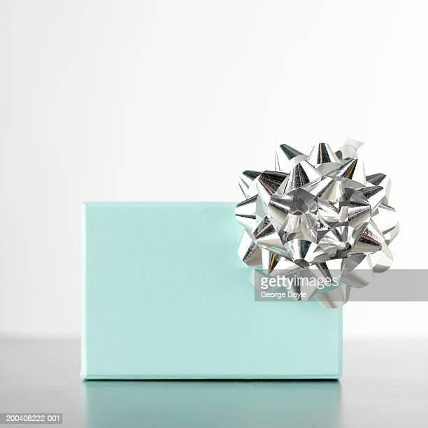 Gift box decorated with silver rosette, close-up